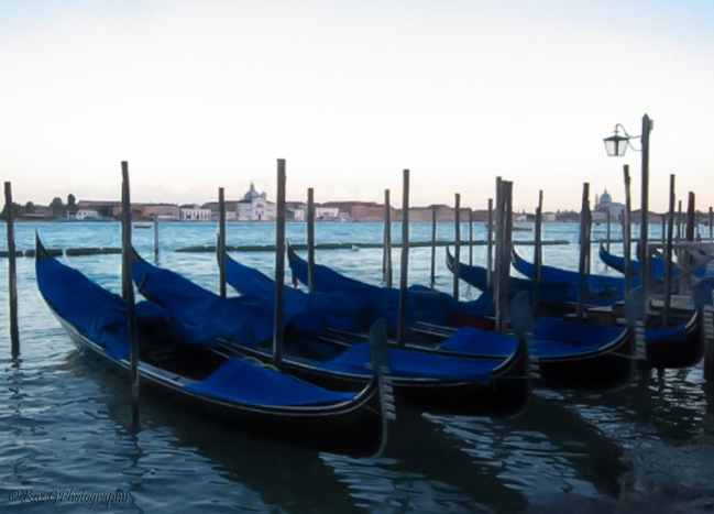 Gondolas moored at sundown